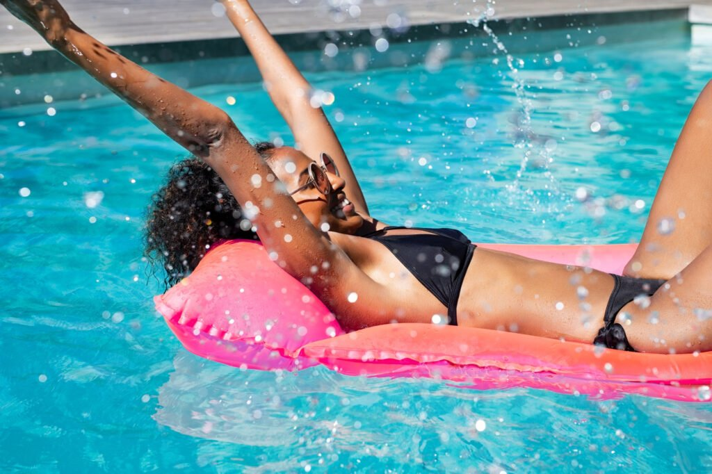 lounging in the swimming pool | How to Have a Stellar Summer Staycation