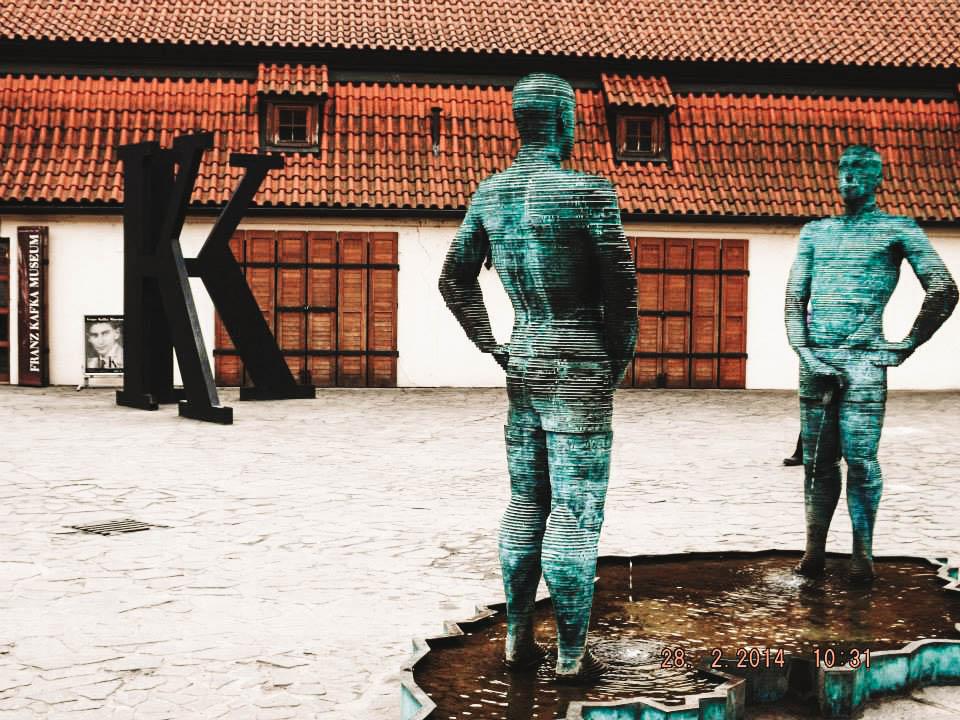 David Cerny sculpture near Kafka Museum Prague | Best Street Art Cities