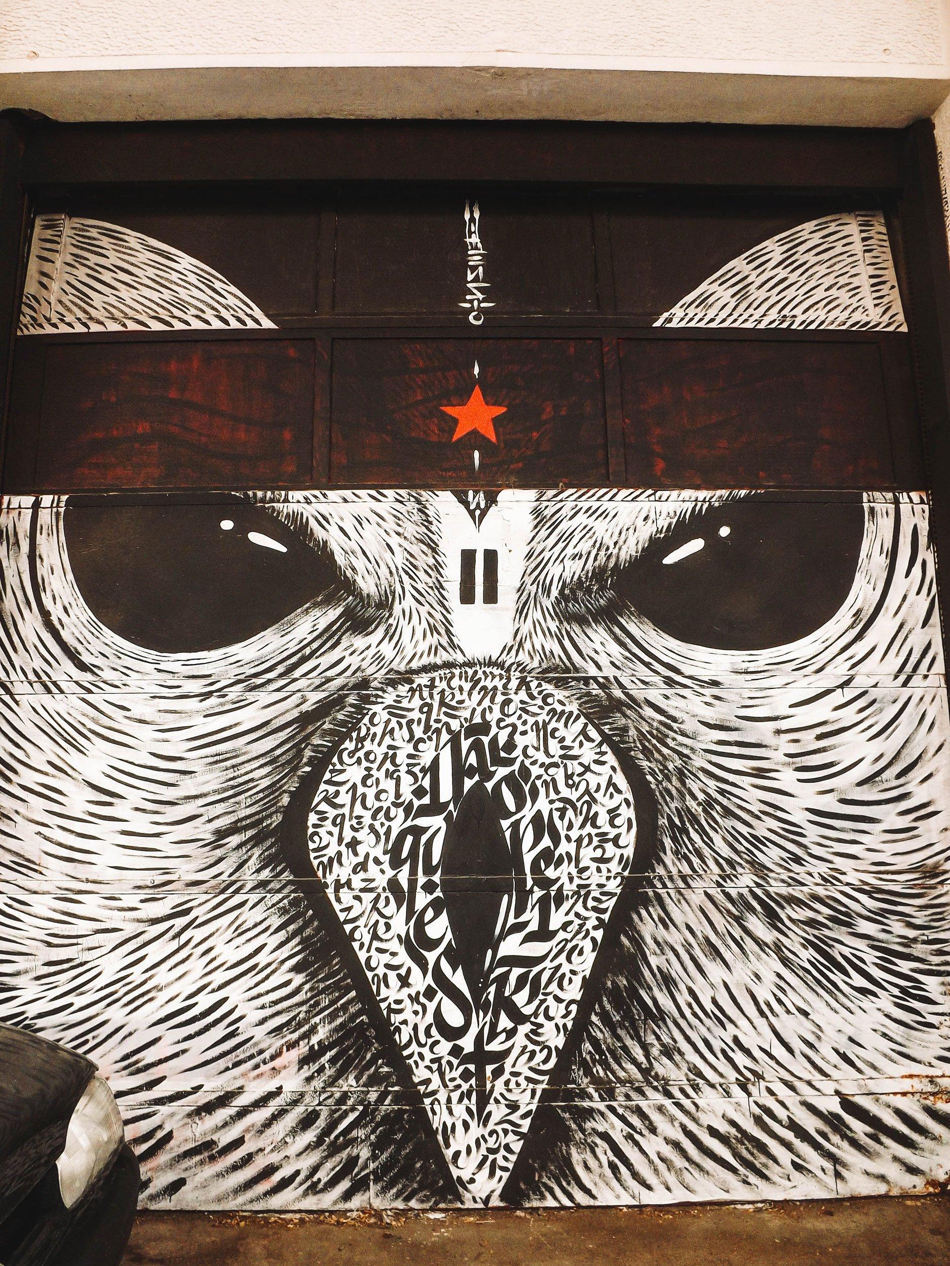 mural by Blaqk Athens | Best Street Art Cities