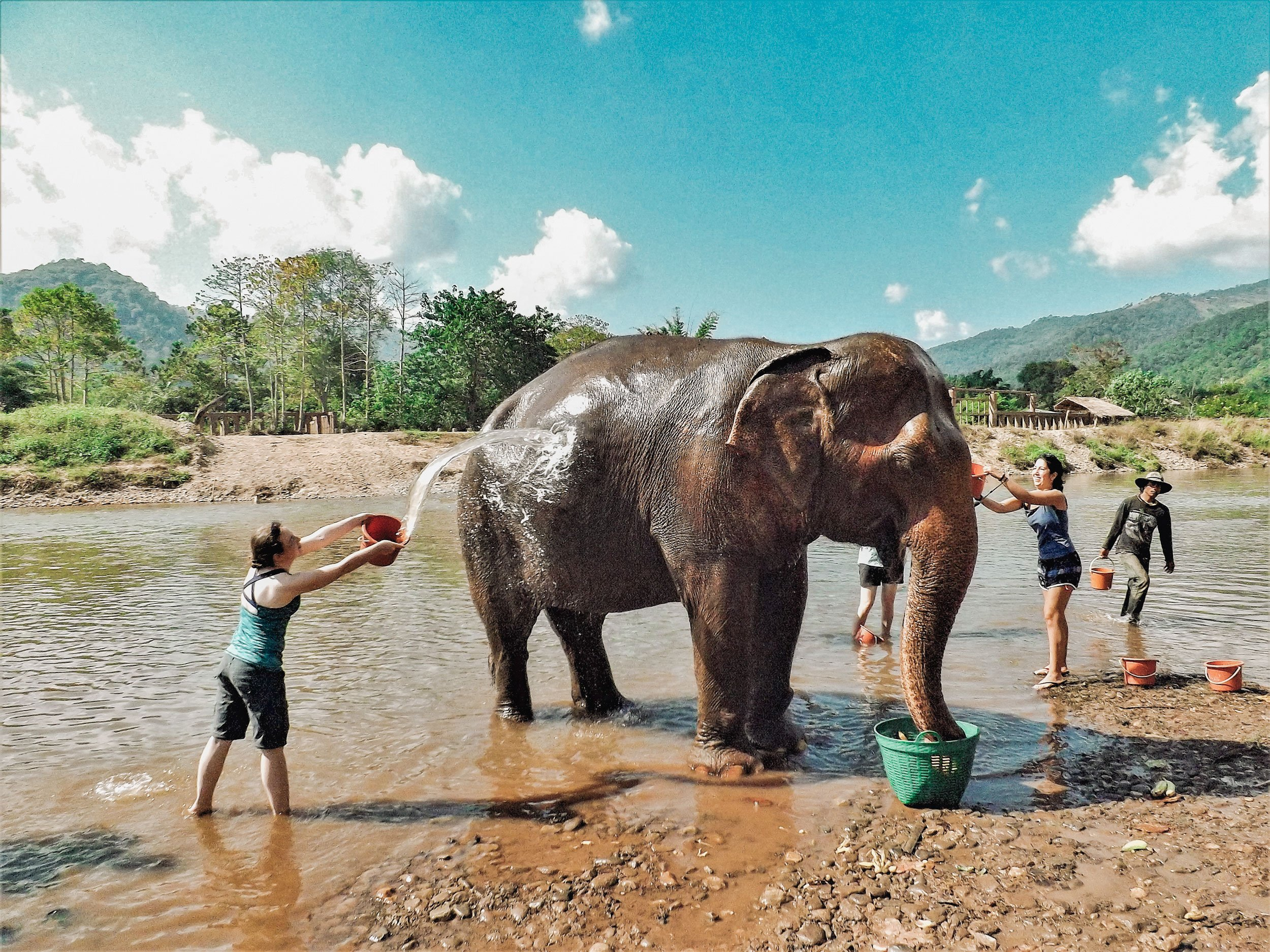 Bathing an elephant in Thailand is the sort of once-in-a-lifetime experience you might include on a RTW trip | What is a RTW Trip?
