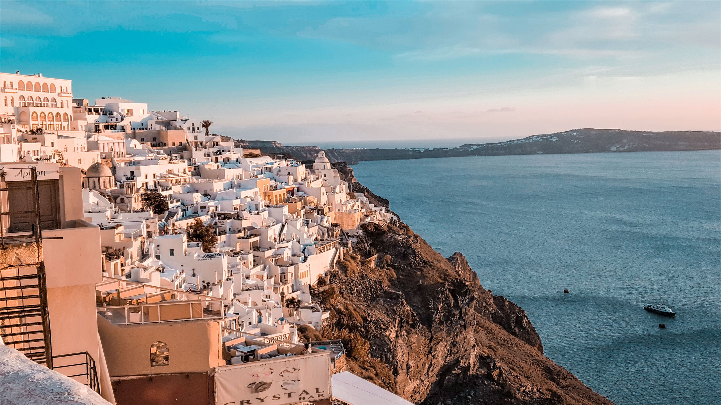 Fira Santorini Greece is one of the safest destinations for solo female travelers on a RTW trip | What is a RTW Trip?
